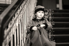 Cute little girl dressed in retro-style coat inside old house Stock Image
