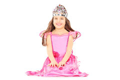 Cute little girl dressed up as princess wearing a tiara. Isolated on white background Stock Photos