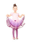 Cute little girl dressed up like ballerina. Isolated on white background Stock Photos