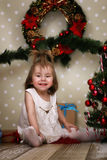 Cute little girl dresses up Christmas tree Royalty Free Stock Images