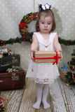 Cute little girl dresses up Christmas tree Royalty Free Stock Photos