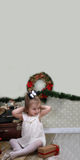 Cute little girl dresses up Christmas tree Royalty Free Stock Image