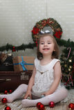 Cute little girl dresses up Christmas tree Stock Images
