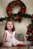 Cute little girl dresses up Christmas tree Stock Photo