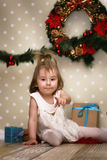 Cute little girl dresses up Christmas tree Stock Photography