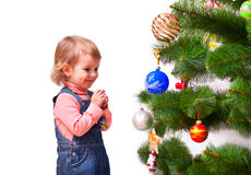 Cute little girl dressing the Christmas tree Stock Photo