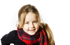 Cute little girl dressing by red comfort scarf Royalty Free Stock Images
