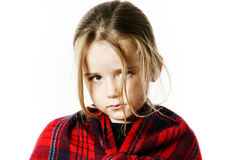 Cute little girl dressing by red comfort scarf Stock Images