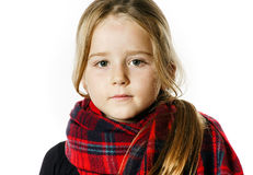 Cute little girl dressing by red comfort scarf Stock Photography