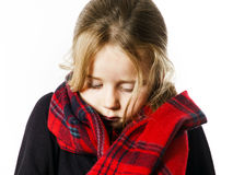 Cute little girl dressing by red comfort scarf Royalty Free Stock Photography