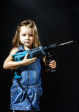 Cute little girl with drilling machine in her hands Royalty Free Stock Images
