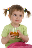 Cute little girl drink carrot juice Royalty Free Stock Photography