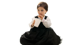 Cute little girl drinking. Isolated on white Stock Photo