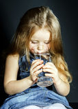 Cute little girl drinking clear water Stock Photography