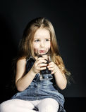 Cute little girl drinking clear water Royalty Free Stock Photo