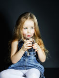 Cute little girl drinking clear water Royalty Free Stock Photography