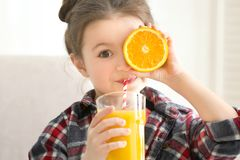Cute little girl drinking juice at home. Closeup Royalty Free Stock Images