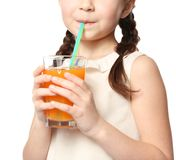 Cute little girl drinking juice on white background,. Closeup Royalty Free Stock Image