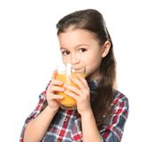 Cute little girl drinking juice. On white background Stock Photos