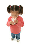 Cute little girl drinking milk Stock Images