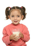 Cute little girl drinking milk Royalty Free Stock Photography