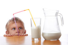 Cute little girl drinking milk. With straw Stock Photos