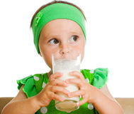 Cute little girl drinking milk from big glass Stock Image