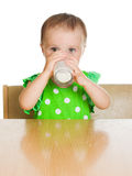 Cute little girl drinking milk from big glass Stock Photography