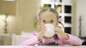 Cute little girl drinking tea stock video footage
