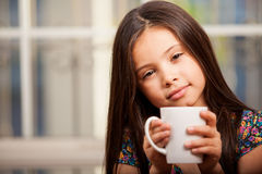 Cute little girl drinking tea Stock Photos