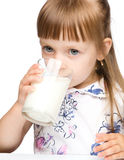 Cute little girl drinks milk Stock Photos