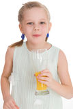 Cute little girl drinks orange juice Stock Photos