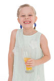Cute little girl drinks orange juice Royalty Free Stock Photos