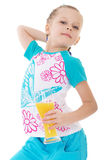 Cute little girl drinks orange juice Stock Images
