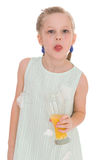 Cute little girl drinks orange juice Stock Photo