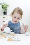 Cute little girl drinks tea Stock Photography