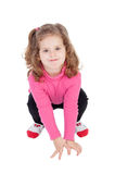 Cute little girl ducking Stock Images