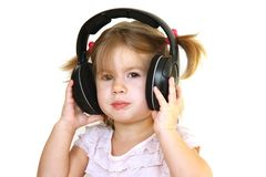 Cute little girl with earphones Stock Image