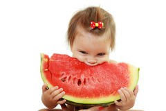 Cute little girl eat watermelon slice Stock Photos