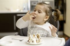 Cute little girl eating Stock Photography