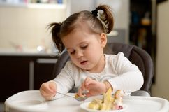 Cute little girl eating Stock Photo