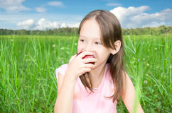Cute little girl eating apple Royalty Free Stock Photography