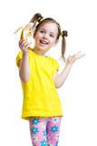 Cute little girl eating banana Stock Photography