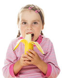Cute little girl eating a banana Royalty Free Stock Photo