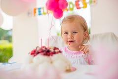 Cute Little Girl Eating Birthday Cake Stock Photo