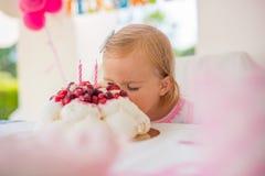 Cute Little Girl Eating Birthday Cake Stock Images