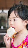 Cute little girl eating bread Royalty Free Stock Photography