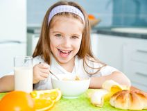Little girl eating her breakfast Royalty Free Stock Image