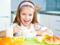 Little girl eating her breakfast Royalty Free Stock Image