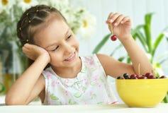 Cute Little girl  eating cherries Stock Photos